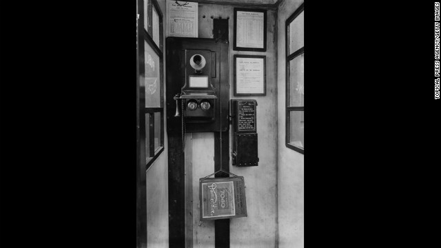 This phone box in Southwark Bridge, London, features a wall-mounted phone with separate mouthpiece and receiver from 1924.