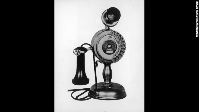 "Rotary-dial telephones with separate mouthpieces and receivers were commonly referred to as ""candlestick"" phones. This model from the mid-1930s features the rotary dial in the shaft of the telephone."