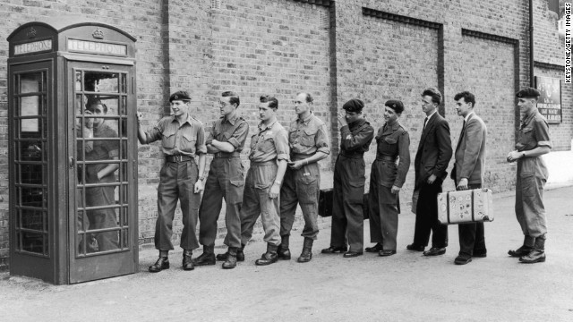 Men of the English Oxfordshire and Buckinghamshire Light Infantry call their loved ones after being told to prepare for duty in the Suez Canal Zone in 1956. Payphones were common up until the cell phones became popular and affordable.