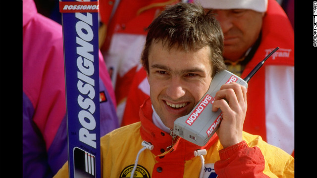 Franck Piccard of France talks on a mobile phone after the Mens Super G Slalom event at the 1988 Winter Olympic Games in Calgary, Canada. He won the gold medal. The phone, however, was shut out.