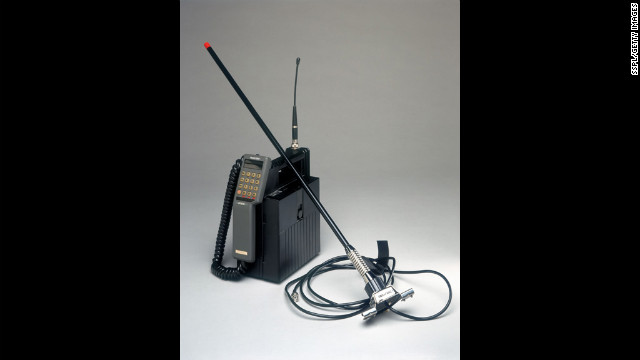 This model of mobile phone was marketed by Racal-Vodac Limited of Newbury, Berkshire, England, in 1997, to serve dual roles as a mobile unit installed in a car or as a portable unit. The unit was sold with a battery charger and extension antenna for use in areas with poor reception.