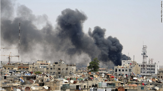Smoke rises after an explosion was heard near the Palace of Justice in central Damascus on Thursday.