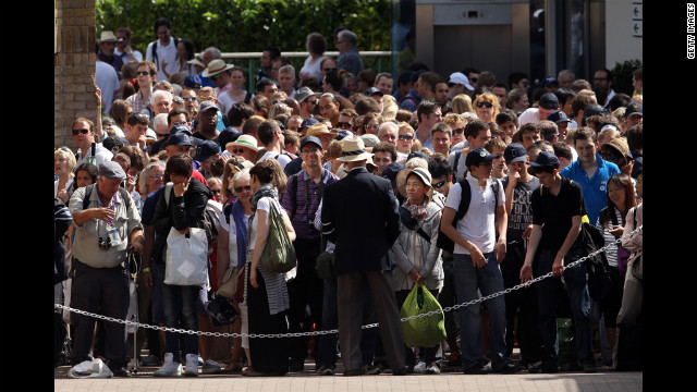 Fans gather to enter the All England Lawn Tennis Club in London for the Wimbledon championships on June 28.