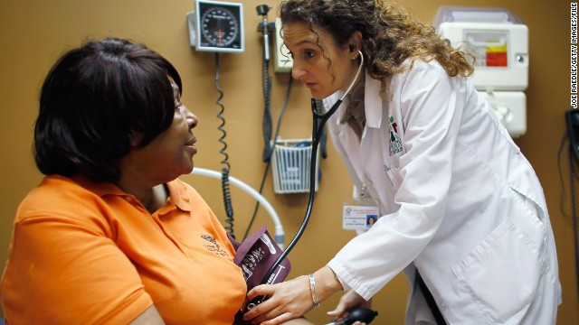 Brenda Major gets a checkup from Dr. Fernanda Mercade at a clinic in Miami on March 22.