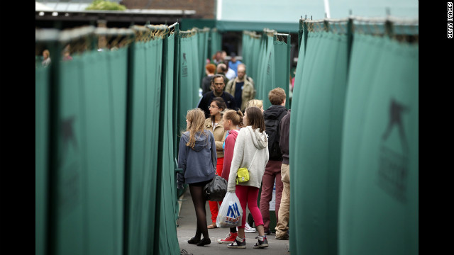 Arriving early, tennis fans walk around the venue Friday.