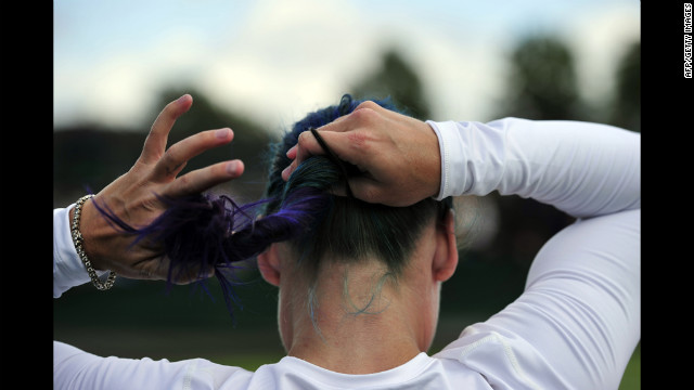 American Bethanie Mattek-Sands ties her hair up Friday during her match with India's Sania Mirza against France's Stephanie Foretz Gacon and Kristina Mladenovic.