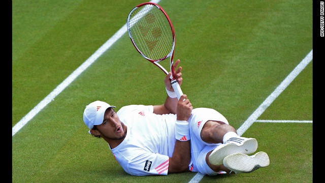 Argentina's Juan Monaco falls in a match Friday against Serbia's Viktor Troicki.