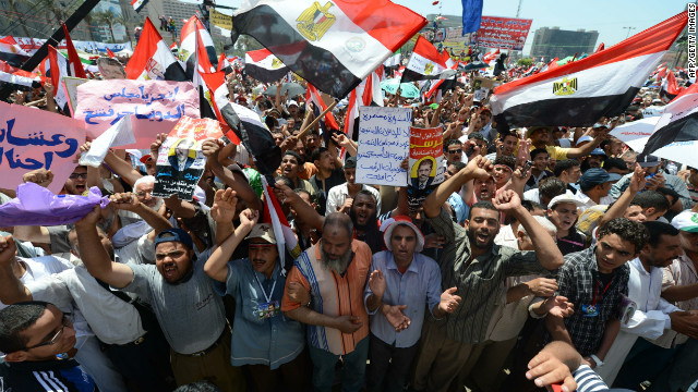 Egyptians wave national flags during a rally in support of president-elect Mohamed Morsi in Cairo's Tahrir Square on June 29.