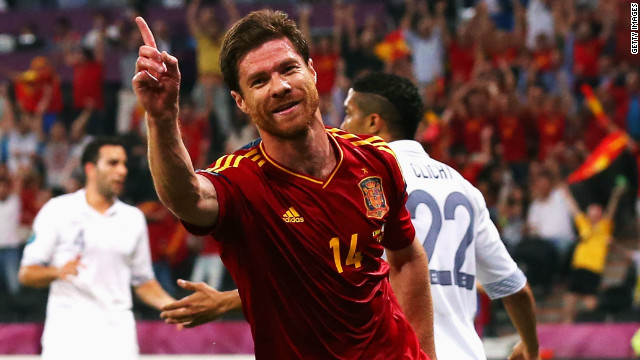 Xabi Alonso scored both of Spain's goals in the quarterfinal against France, leading the champions into a showdown with neighbors Portugal on the occasion of his 100th cap.<br/><br/>