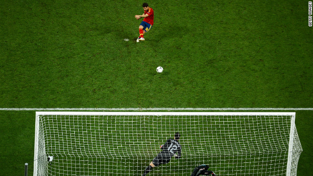 Cesc Fabregas' scuffed penalty went in off the post as Spain beat Portugal in their semifinal shootout to earn a place in the final against Italy in Kiev on Sunday.<br/><br/>