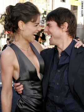 The couple mug for the cameras at the &quot;Batman Begins&quot; premiere in June 2005.