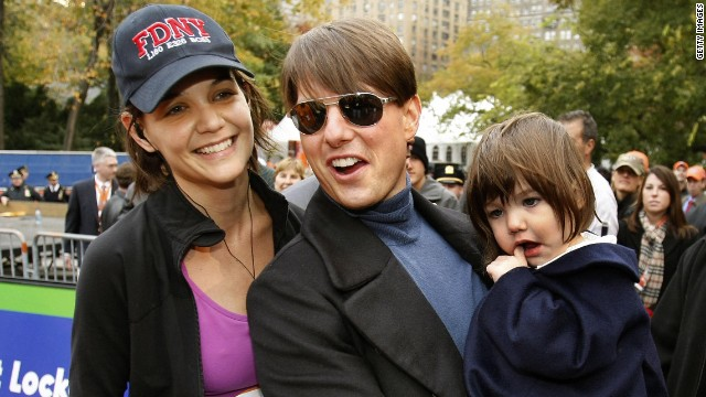 Tom Cruise and Suri waited at the finish line to greet Katie Holmes after the New York City Marathon in 2007.