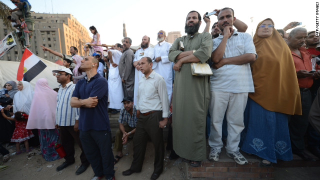 Egyptians in Cairo's Tahrir Square listen to a speech from President-elect Mohamed Morsi on Friday.