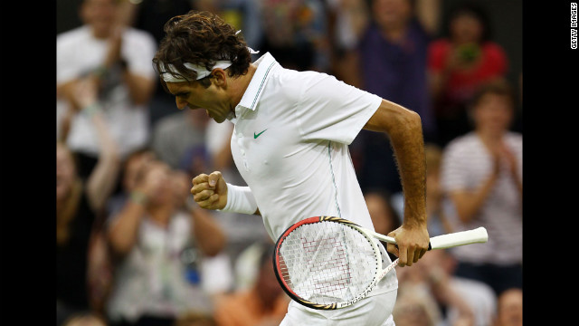 Roger Federer of Switzerland celebrates set point during his third-round singles match against Julien Benneteau of France in the Wimbledon Championships in London on Friday, June 29.