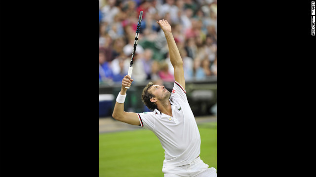 Julien Benneteau serves during his third-round men's singles match against Roger Federer on Friday.