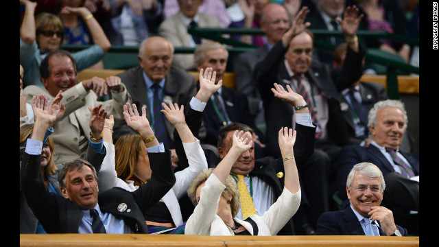 "People in the Royal Box at the All-England Club take part in a ""wave"" on Friday."