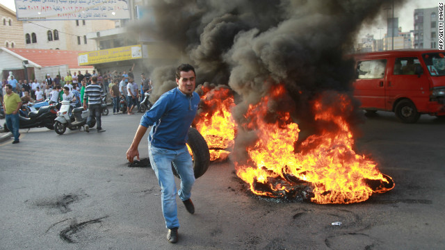 Burning Tires Symbol Of Conflict To Sign Of Peace Cnn Com