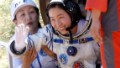 China's first female astronaut, Liu Yang, waves as she emerges from the return capsule of the Shenzhou-9 spacecraft.