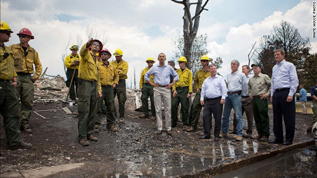 President Barack Obama tours fire damage with elected officials and firefighters in the Mountain Shadows residential neighborhood in Colorado Springs, Colorado, on Friday, June 29. The massive fire has destroyed hundreds of homes and forced more than 36,000 people to flee<span/>.<br/><br />