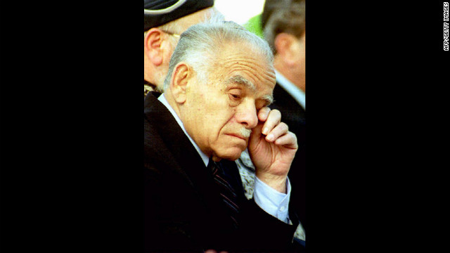 Shamir wipes his eye during a commemorative ceremony on May 5, 1992, in Jerusalem for soldiers who died in Israel's wars.