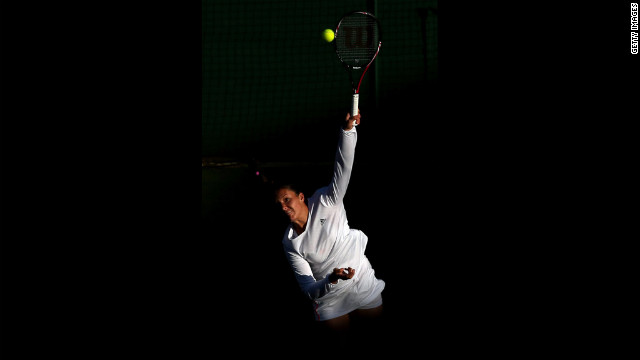 Laura Robson of Great Britain serves during a mixed doubles second-round match on Saturday. She and Dominic Inglot were paired against Jurgen Melzer of Austria and Iveta Benesova of the Czech Republic.