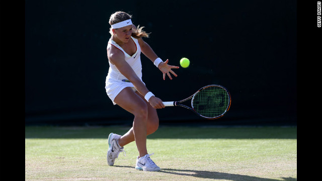 Laura Pigossi of Brazil makes a backhand return during her first-round match against Lana Rush of Great Britain in girls' singles on Saturday.
