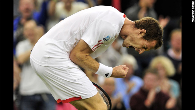 Britain's Andy Murray celebrates taking the third set of his third-round men's singles match against Cyprus' Marcos Baghdatis on day six of Wimbledon on Saturday, June 30.