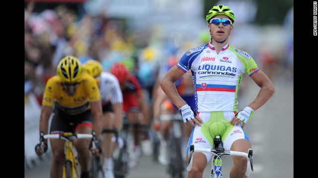 Peter Sagan of Slovakia celebrates on the finish line as he wins Stage 1, just ahead of Fabian Cancellara of Switzerland, on Sunday in Seraing, Belgium.