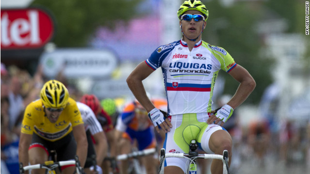 Peter Sagan of Slovakia crosses the line ahead of the yellow jersey of Fabian Cancellara on the first stage of the 2012 Tour de France.