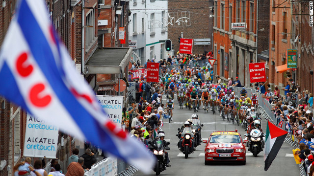 The peloton begins the final climb of Sunday's stage, called the Cote de Seraing, as riders near the finish of the 198-kilometer (123-mile) course.