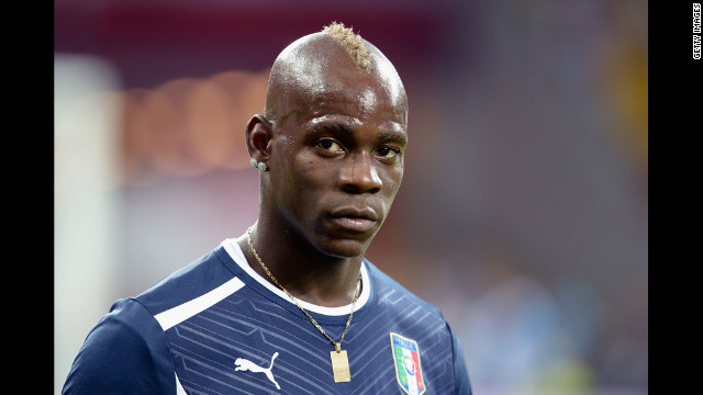 Italy's Mario Balotelli of Italy warms up ahead of Sunday's match againt Spain.