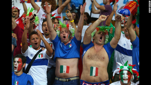 Italy fans cheer ahead of the match against Spain.