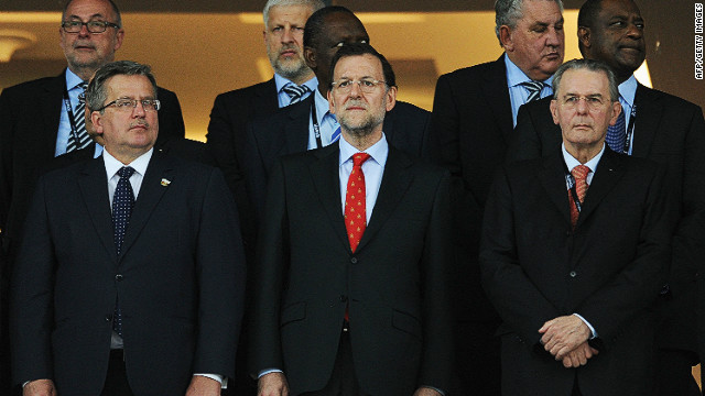 Spanish Prime Minister Mariano Rajoy (center) attends the Euro 2012 final at the Olympic Stadium in Kiev.