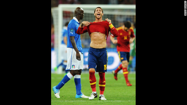 Spain's Sergio Ramos of Spain reacts next to Mario Balotelli of Italy during the match on Sunday.
