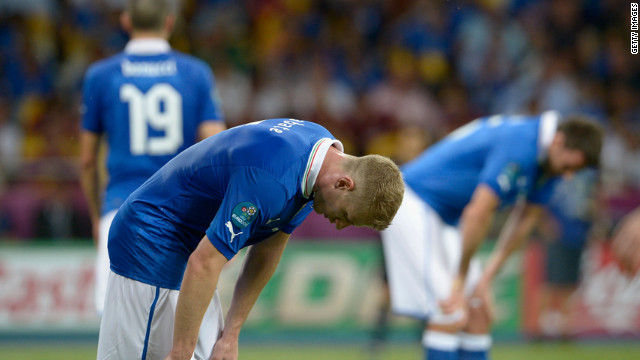 Ignazio Abate of Italy, left, shows his dejection after Spain scored a second goal.