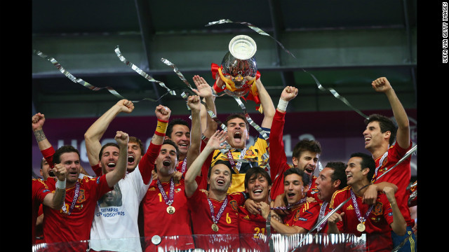 Spain celebrates after defeating Italy on Sunday. It was the team's third successive major international trophy.