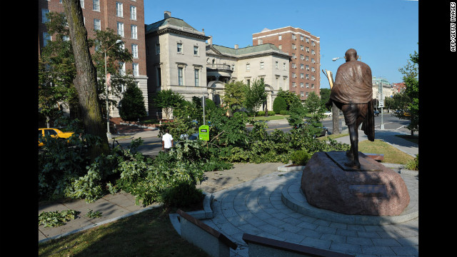 Tree branches lie near the statue of Mohandas K. Gandhi at Dupont Circle in Washington. The storms produced hurricane-force winds in excess of 80 mph.