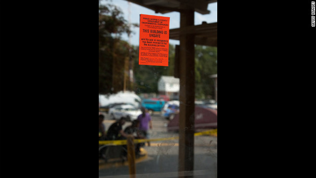 A public notice is displayed on the mirrored doors of the seven-story Park Tanglewood Apartments in Riverdale.