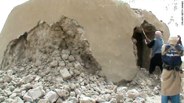 Islamist militants destroy an ancient shrine in Timbuktu on July 1 in a still from a video.