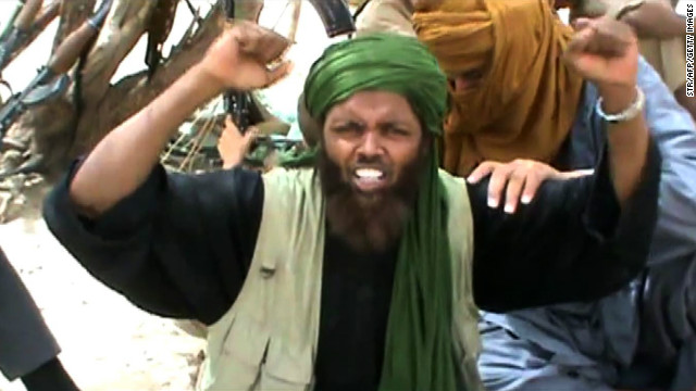 An Islamist militant celebrates and shouts &quot;Allahu Akbar&quot; (God is Greatest) after destroying an ancient shrine in Timbuktu.