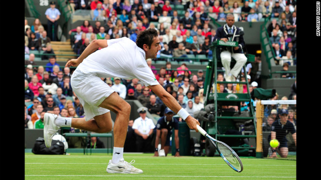 Croatia's Marin Cilic reaches for a shot during his match against Britain's Andy Murray.