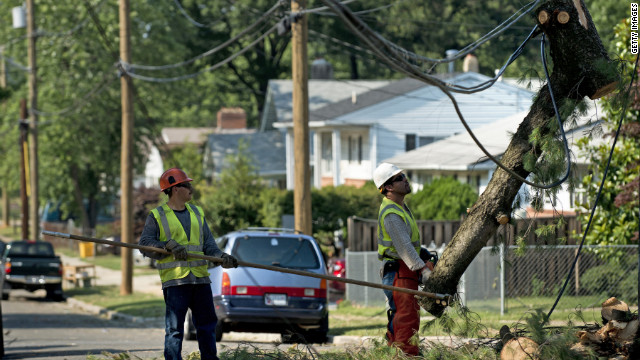 Workers repair power lines in Hyattsville, Maryland, on Sunday. David Frum says buried power lines would help.
