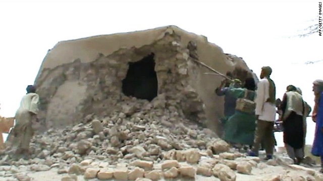 Islamist militants destroying the ancient shrine of a Muslim saint in Timbuktu, Mali, on July 1, 2012.