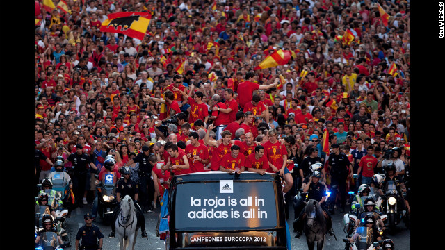 Spain's soccer team celebrates with the Euro 2012 trophy on a double-decker bus during the victory parade in Madrid on Monday. Spain defeated Italy 4-0 in the final match on Sunday. Euro 2012, bringing together 16 of Europe's best national soccer teams, began June 8 in Poland and Ukraine. Look back at the action and atmosphere.