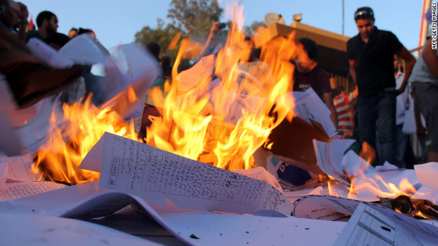 Pro-federalism Libyan protestors burn election materials outside the Electoral Commission in Benghazi on Sunday.