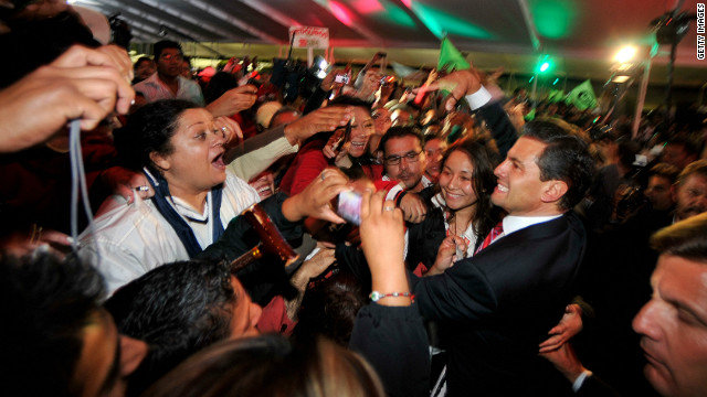 Pea Nieto greets supporters in Mexico City after polls closed and results stacked in his favor early Monday, July 2.