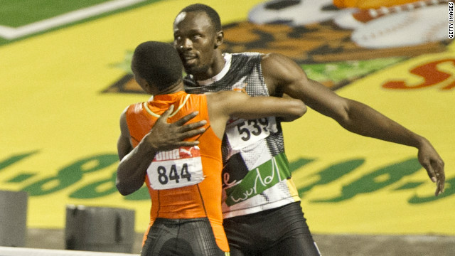 Sprinters Usain Bolt and Yohan Blake embrace after the latter clinched 200m victory at the Jamaican trials.