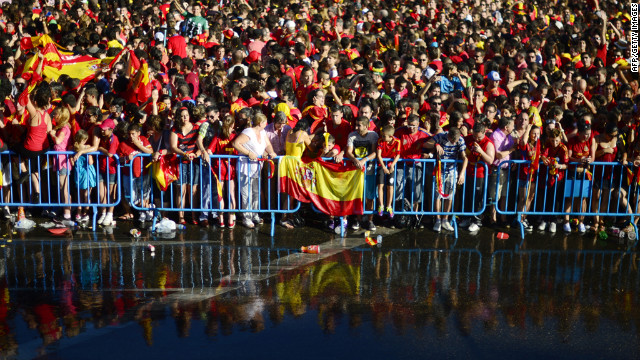 Fans celebrate in Cibeles Square during the victory parade. Organizers had the crowd cooled off with hoses.