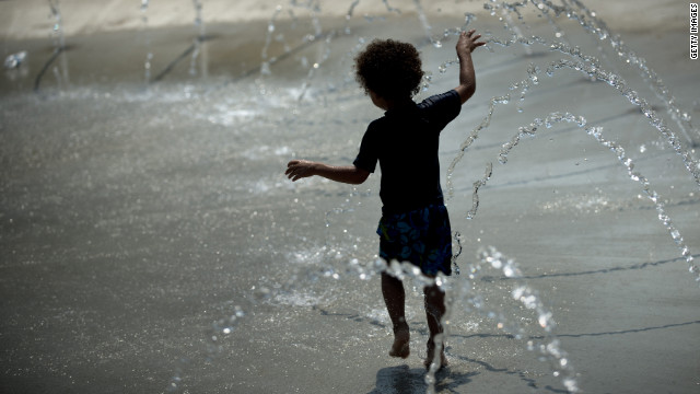 A boy plays in a water fountain in Washington on Sunday, July 1, amid a record-setting heatwave in the eastern United States.