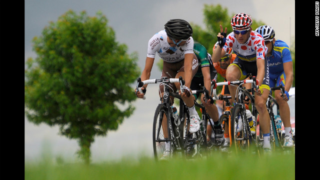 France's Sebastien Minard, left, and Denmark's Michael Morkov, in the polka-dot jersey, lead a breakaway in Stage 3.